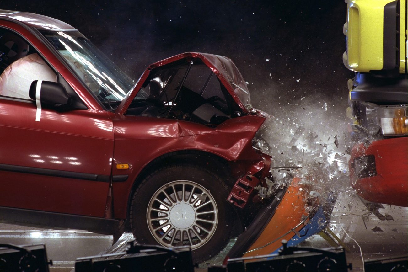 Crash test. Saab 900 into Scania R144 Topline at 57 km/h, impact sequence 0.4 s.