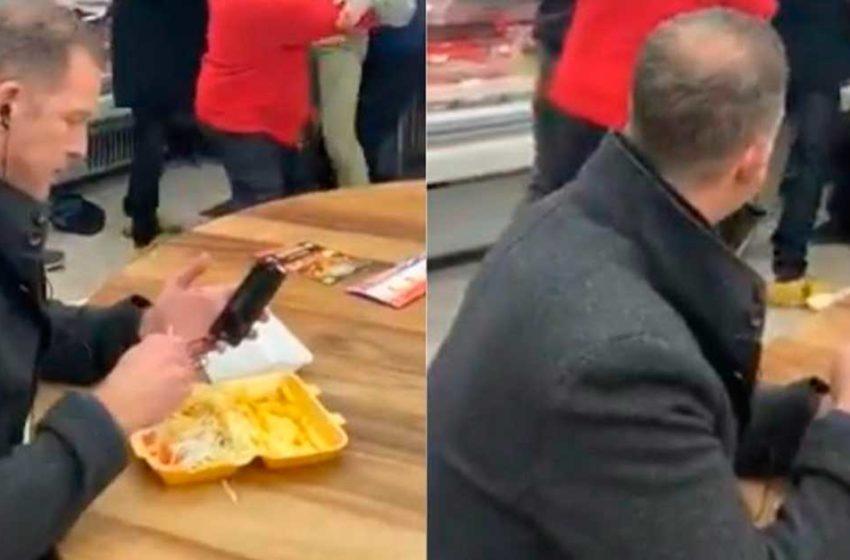 Homem se mantém indiferente durante briga em lanchonete